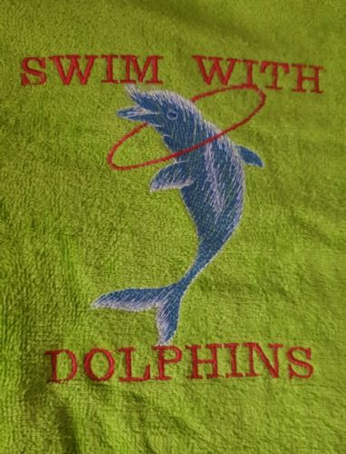 Green velour beach towel swim with dolphins logo